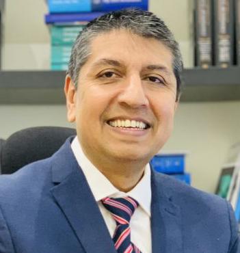 Dr. Parminder J Singh